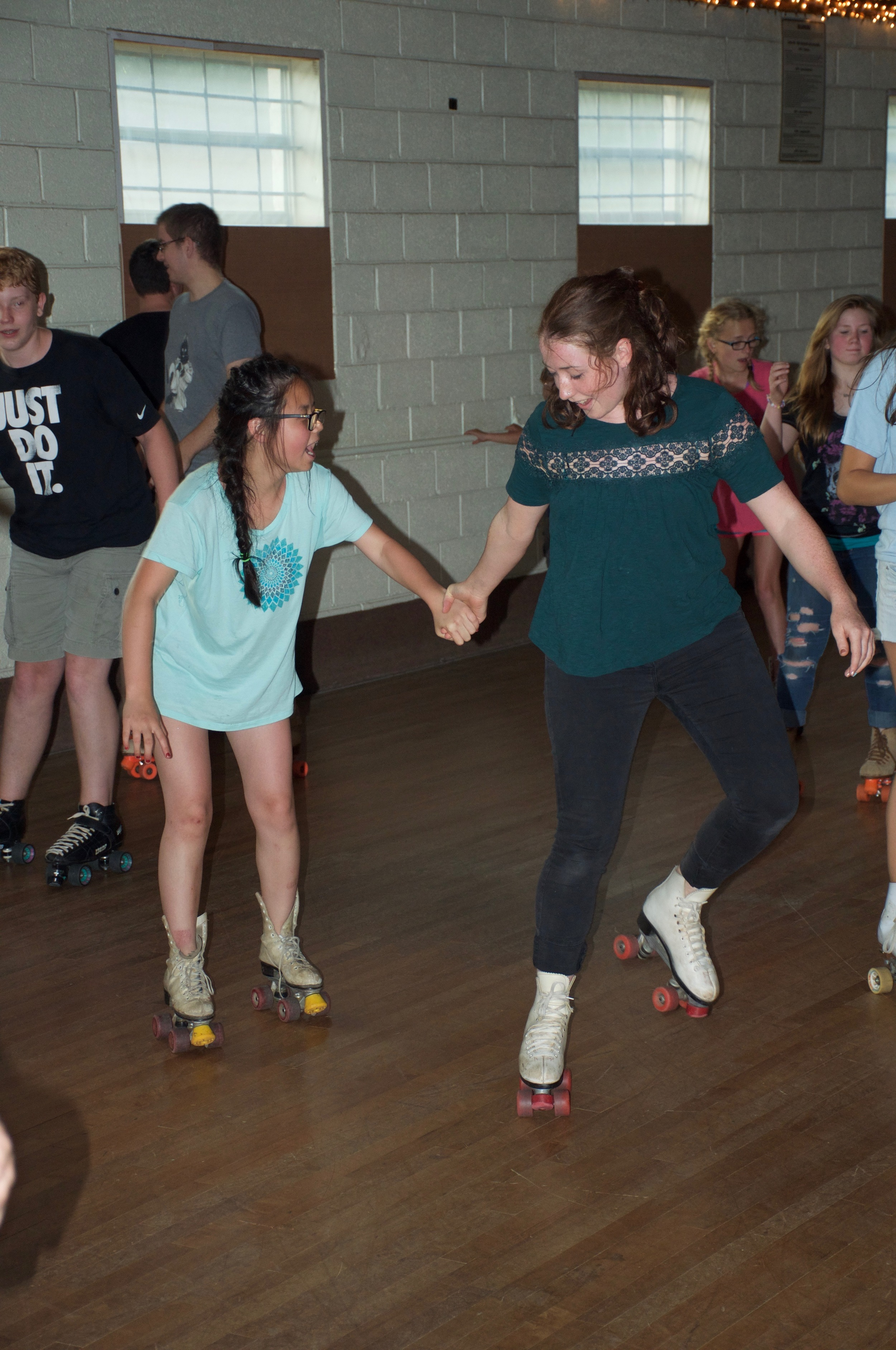 K.and G are getting the hang of rollerskating.