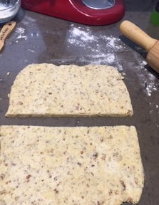 Dough rolled out and cut in half horizontally