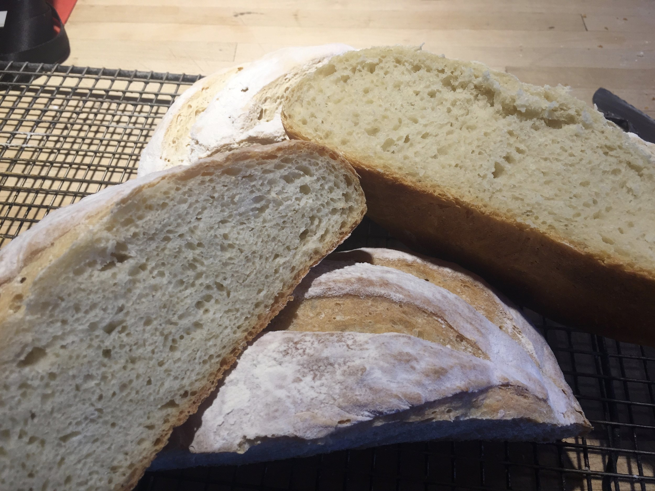 The bread flour loaf has a golden crust and a good crumb - the hydration was low, 71% so I was not expected big air holes in the crumb. Still you can see the cake flour loaf has a cottony crumb and had no crust color. Bleaching flour removes all the carotenoid pigments.