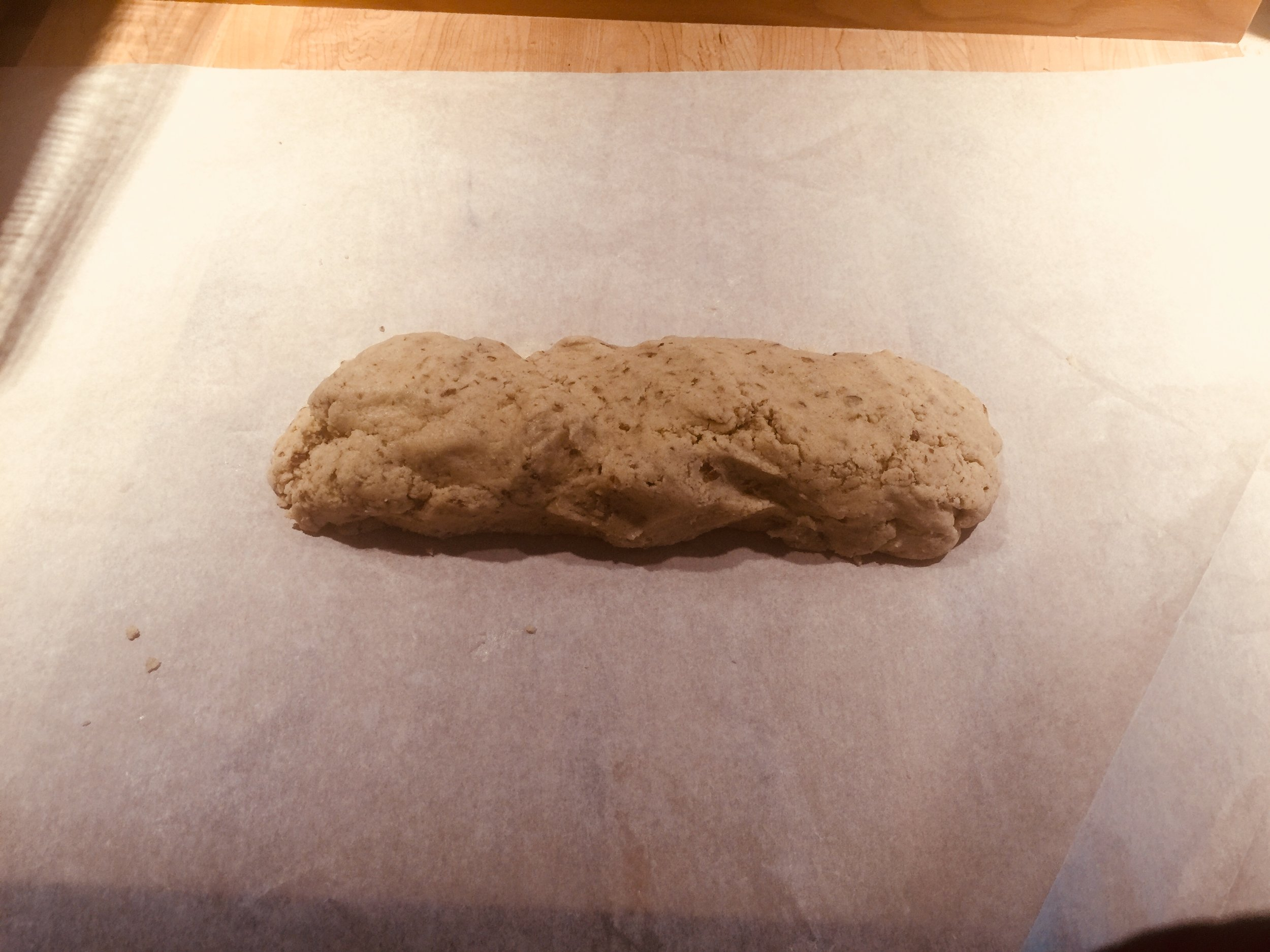 """Dough log on paper - ready to shape - the goal is 18"""""""