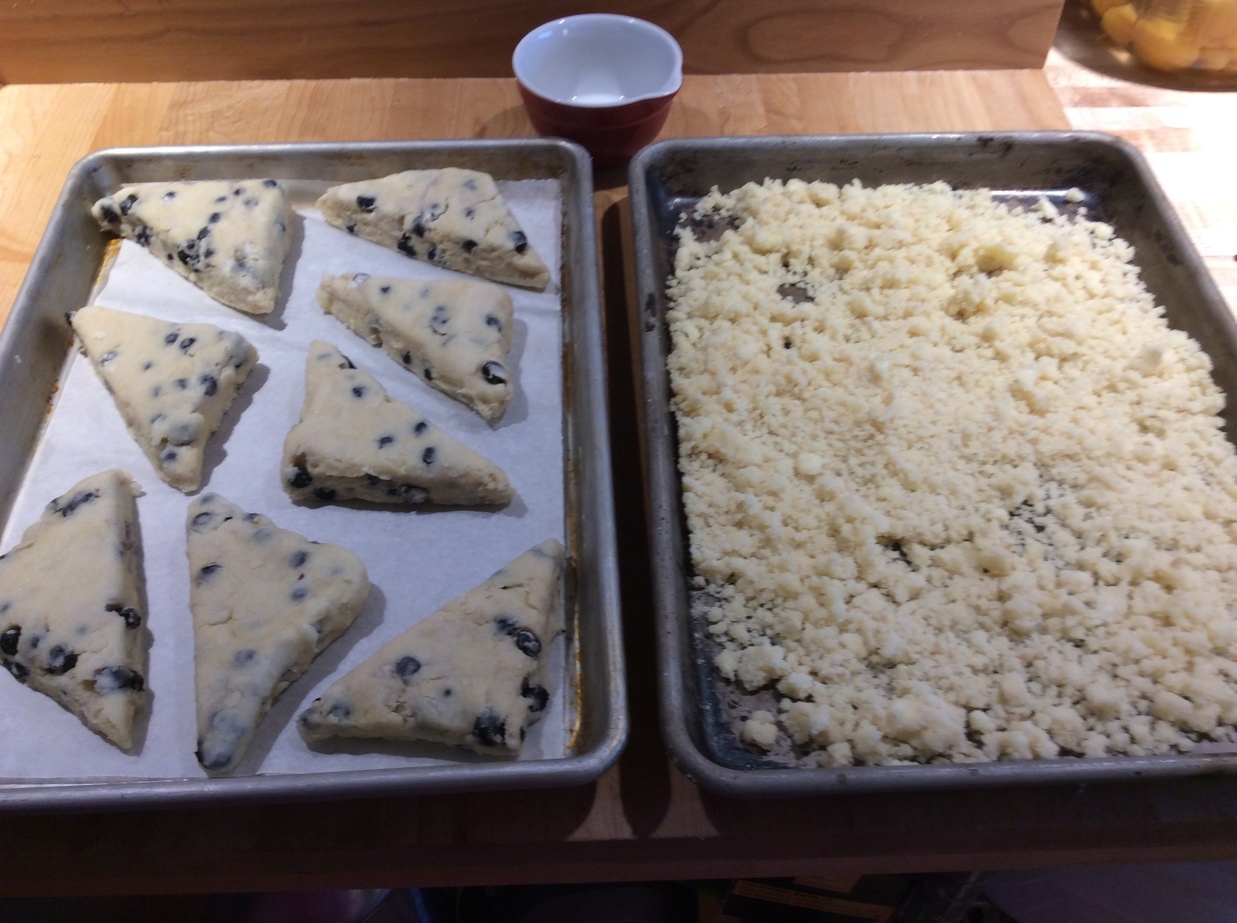 Into triangles arrange on a parchment lined tray, brush with milk and top with butter streusel
