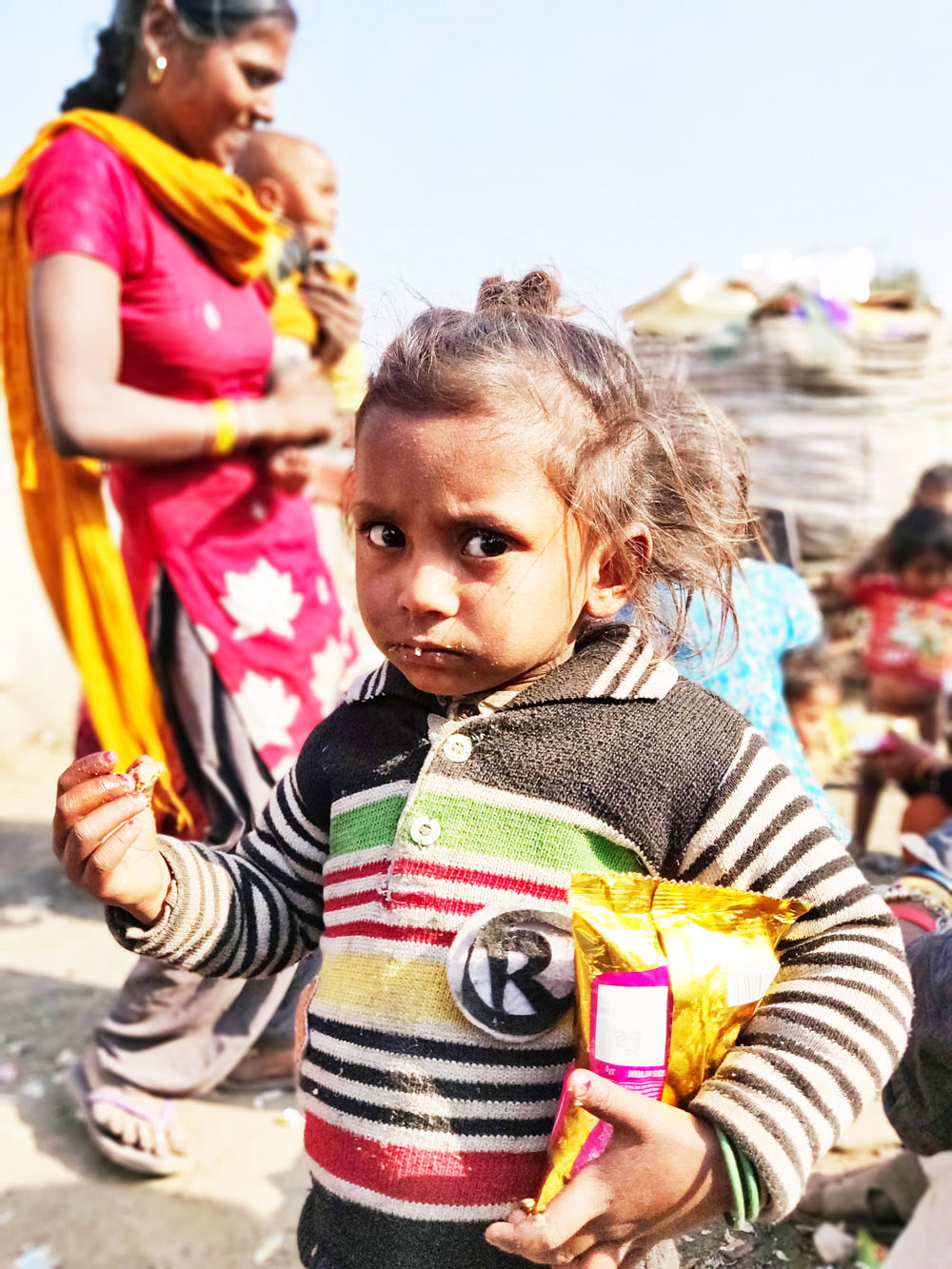 FOOD DISTRIBUTION IN THE SLUMS OF INDIA