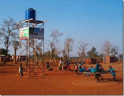 Children at a Playpump and the water storage tank