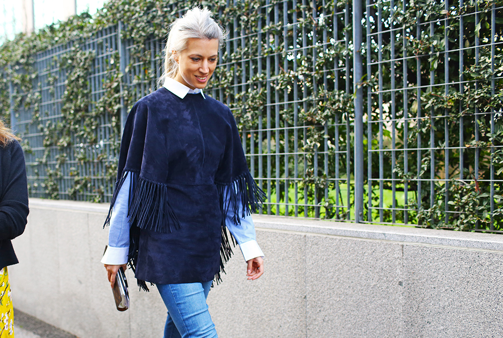 Sarah Harris , Fashion Features Director for  British Vogue, in a fringed, navy, suede ponch