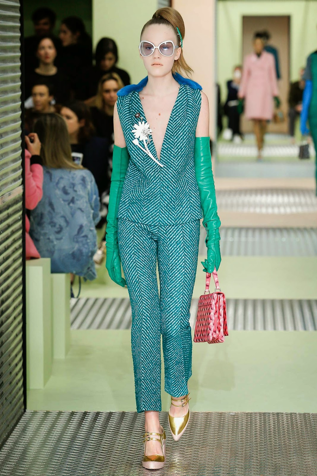 Bejeweled floral brooches served as statement pieces on the  Prada FW 2015 runway