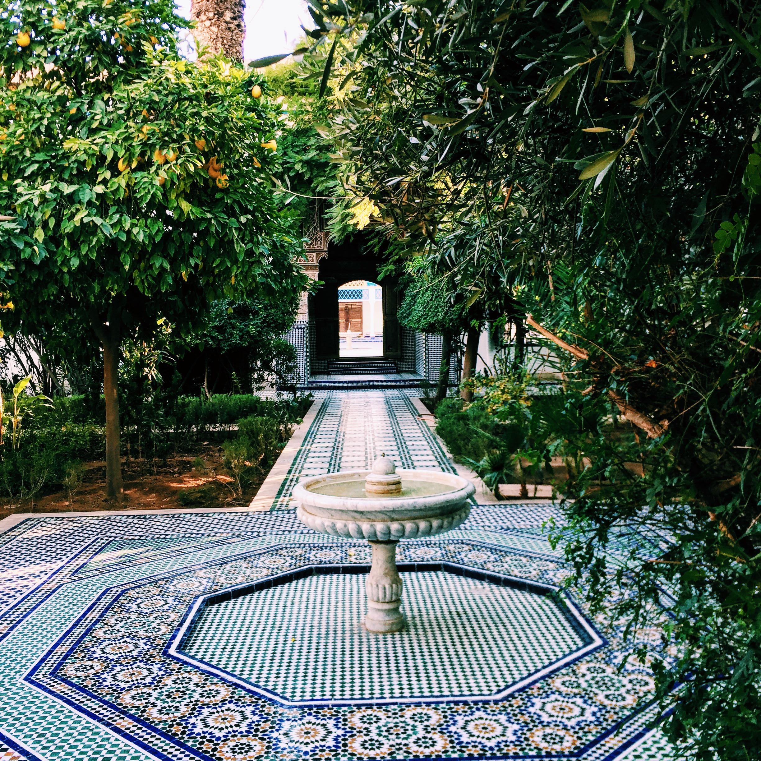 Interconnected courtyards and colorful tiles framing fountains are a trademark of Moroccan palaces, here at the Bahia Palace.