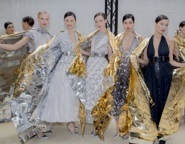 Models waiting for the final bow; image  via
