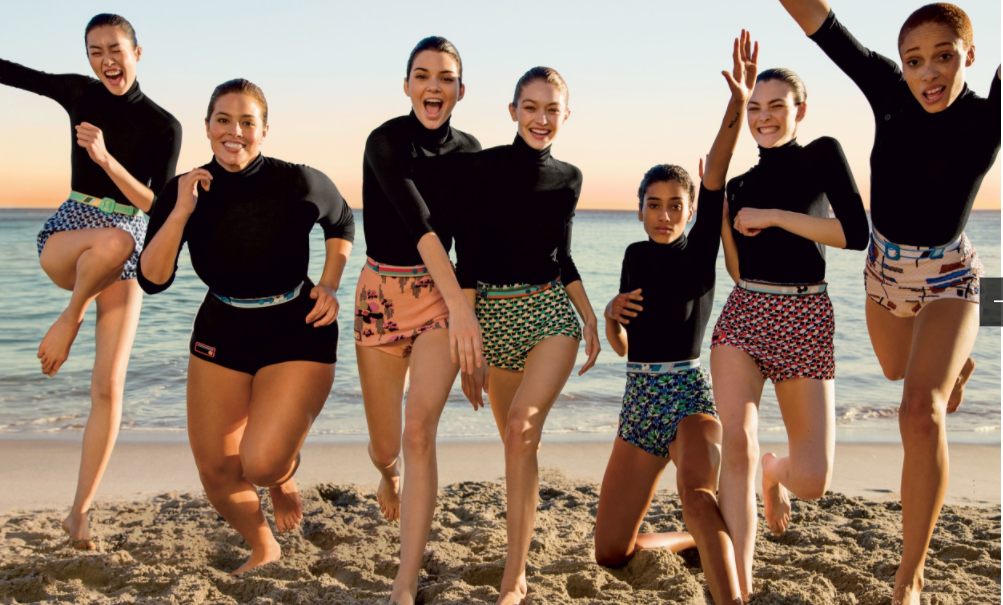 The cover girls frolicking on a beach in Malibu; image  via