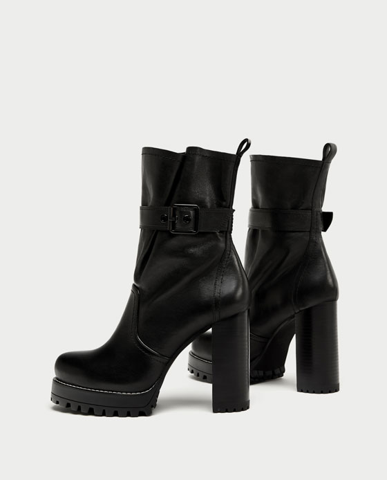 Leather High Heel Ankle Boots - Zara has finally fulfilled the dream of all angsty, short girls of this generation. I've been searching for a combat-boot hybrid with a platform shoe, and these boots are everything. The mere height of the heels are enough of a statement, but the matte black finish pairs easily with leather pants, normal leggings, or your favorite pair of denim jeans. It's my newest fall staple.