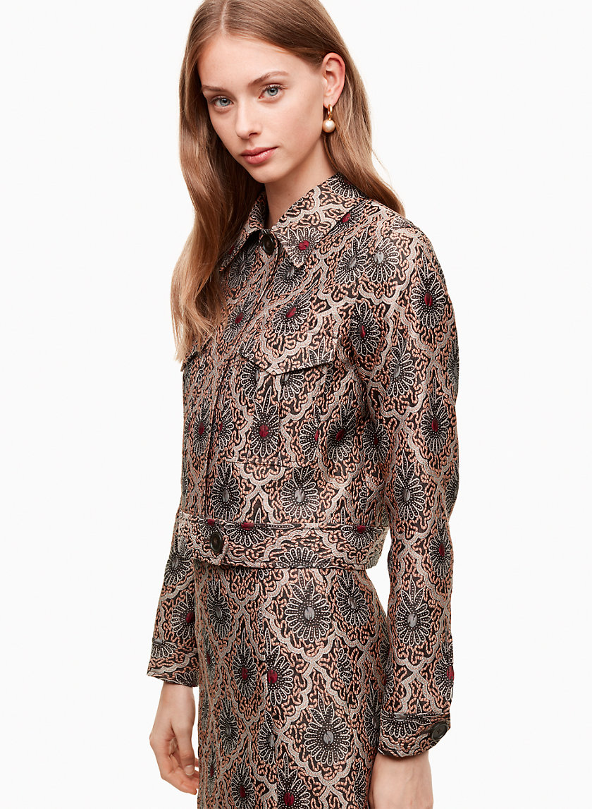 Claire Jacket - Cut from an elevated jacquard from one of Italy's finest mills, this jacket's floral pattern takes its cues from vintage-inspired wallpaper. A cropped silhouette and exaggerated front pockets play into the retro feel.Shop here.