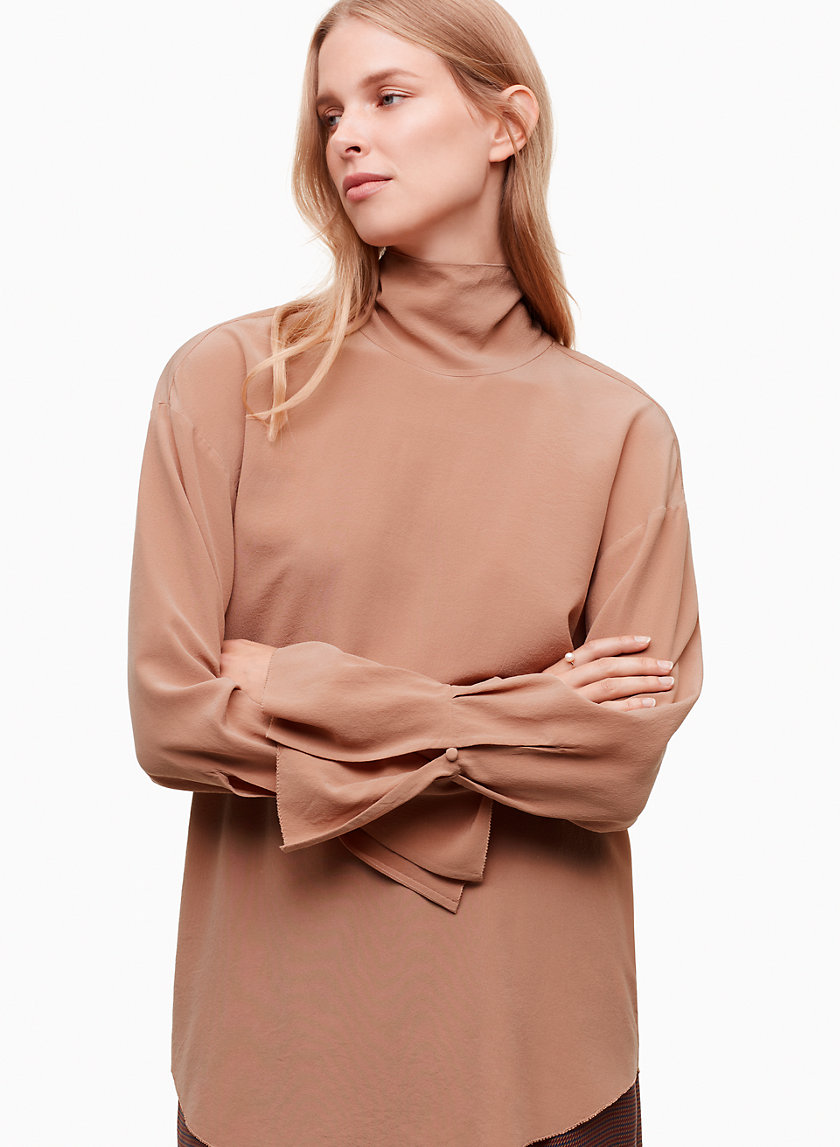 Marinet Blouse - The Marinet is made with pure silk that's been washed for a vintage look and feel. The tie neckline is adjustable, and a flounce sleeve adds a bit of soft volume.Shop here.