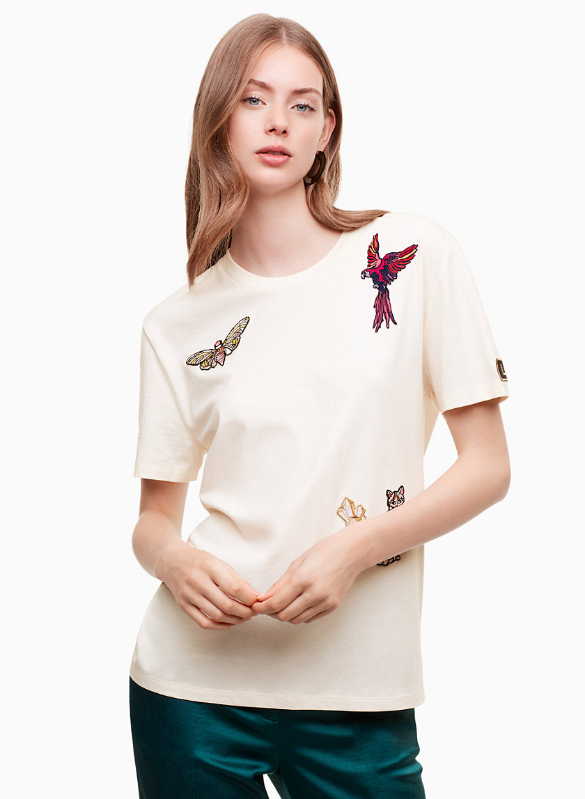 Ageratum T-Shirt - Soft and comfy, this pure cotton t-shirt has a relaxed silhouette and a hip-length hem. This version is embellished with custom embroidery made exclusively for Little Moon.Shop here.