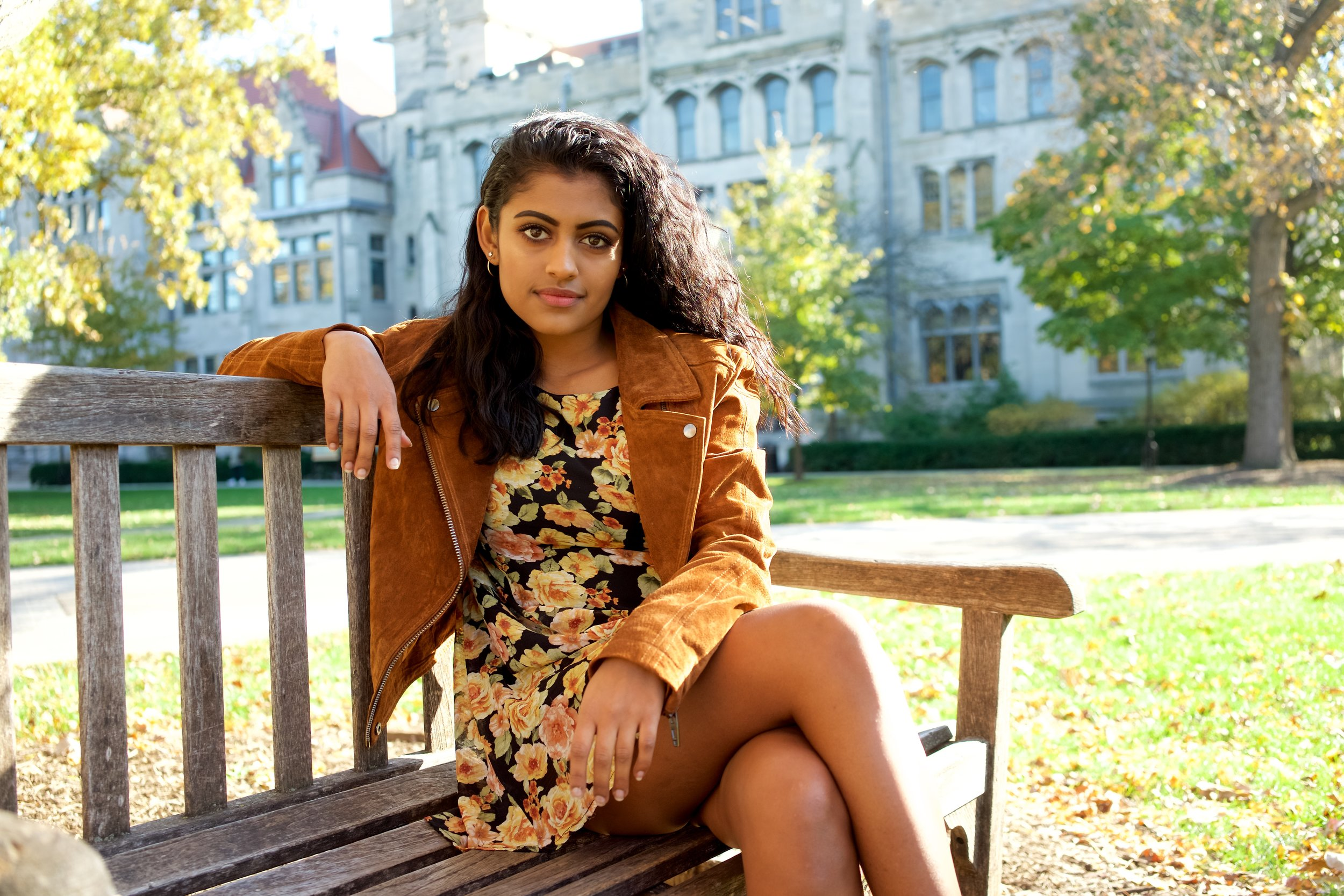 In this outfit,Yamini is wearing: a Suede Jacket from BLANKNYC, a dress she thrifted, boots from Doc Marten, and the same sparkly socks from H&M.
