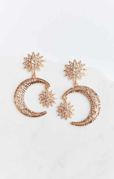 Statement Earrings - There is no easier way to elevate an outfit than to wear a pair of statement earrings. I've been steadily amassing them from my shopping trips, and I have to say, they really do make the outfit. My favorite pair yet is a Baublebar pair of moon earrings that I procured at Akira! Image via