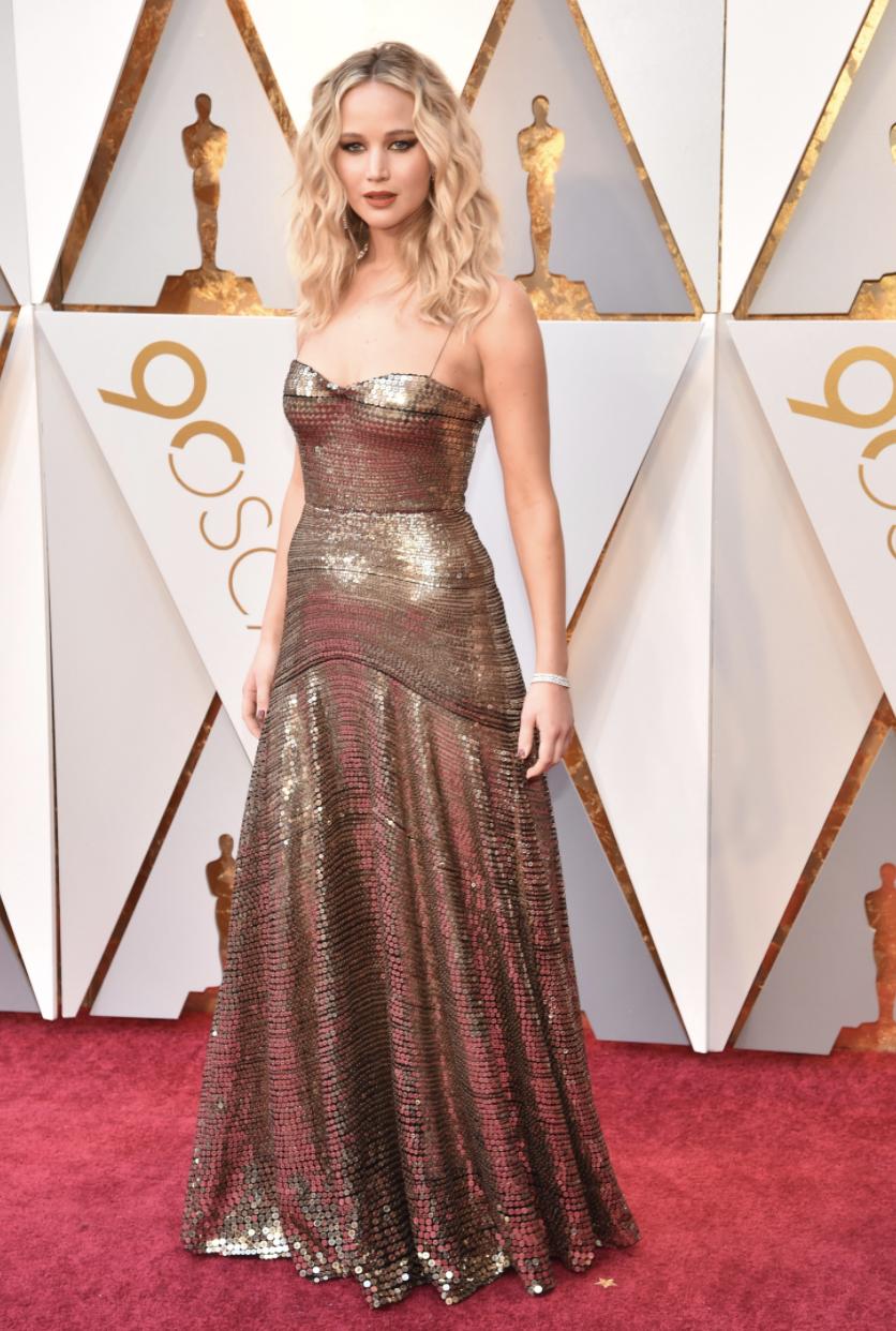 Jennifer Lawrence in head-to-toe Dior   Image  Via