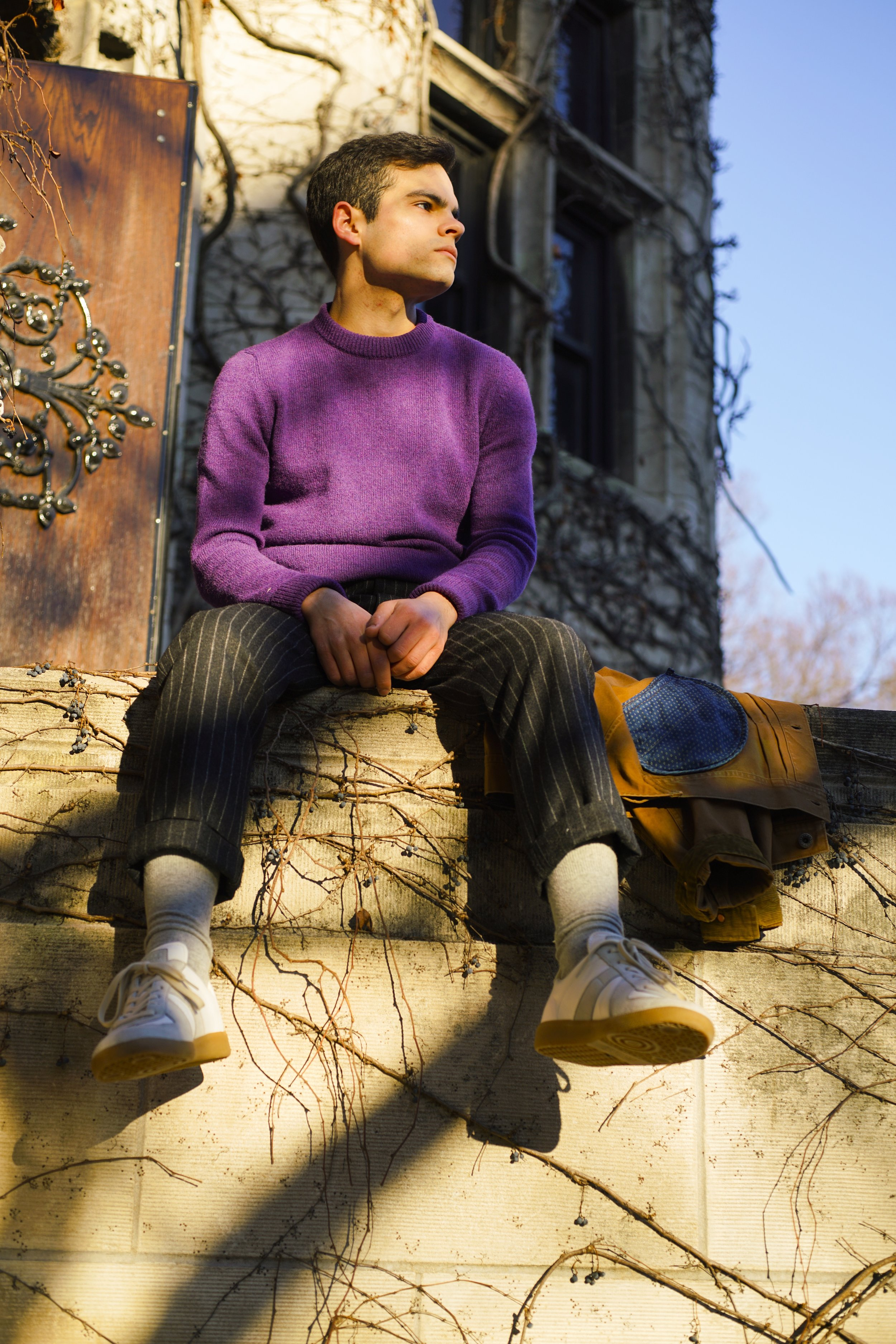 looking off into the distance purple sweater.jpg