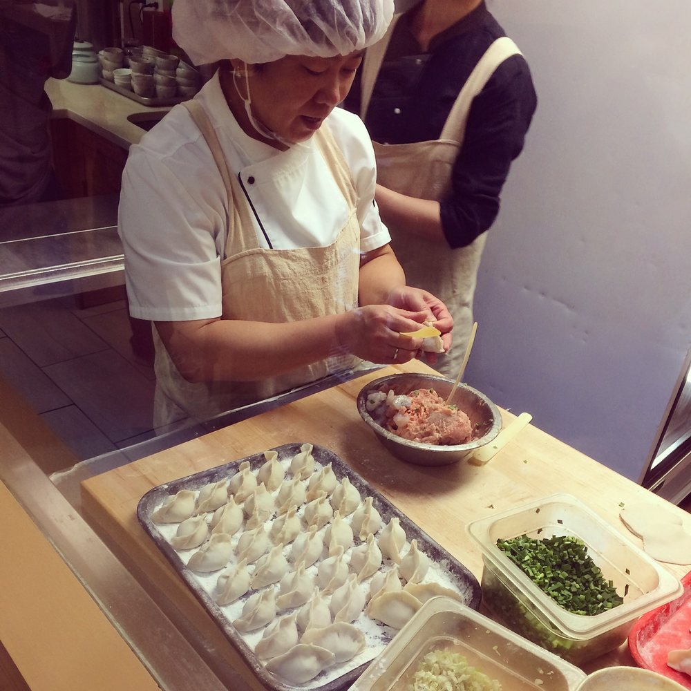 At the back of the restaurant, one can view the dumpling-making process through a window.