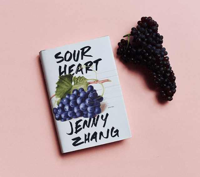 """Jenny Zhang's Sour Heart - I was first introduced to Jenny Zhang's work several months ago when a friend sent me her essay """"How It Feels,"""" and I immediately fell in love with her writing. I recently read her most recent book Sour Heart, a collection of seven short stories that depict the Chinese-American experience through the voices of various young Chinese-American girls living in New York. The stories in Sour Heart tackle a number of themes, such as poverty, strained relationships within families, and the struggle for independence. Zhang's writing style is certainly unique, from her frequent usage of run-on sentences to her very explicit descriptions, some of which are definitely uncomfortable to read. However, Zhang's uncensored writing allows her describe the most joyful of joys and most painful of pains; even if some people love her writing and some people hate it, they are guaranteed to at least feel something. Perhaps my experience with Sour Heart was improved by how I found the content to be incredibly relatable; many of her characters were almost exact copies of people in my life. The dynamic within Chinese-American families is difficult to describe to those who have not experienced it, and because there are not a lot of Chinese-American writers with a platform prominent enough to allow them to reach a broad audience, it feels special to find a work that articulates it so well. Sour Heart proves to be a heartfelt depiction of life as a young Chinese-American girl, though it is too complex to be boiled down into a few adjectives. The only way to truly understand Zhang's ideas is to read her masterpiece of a short story collection."""