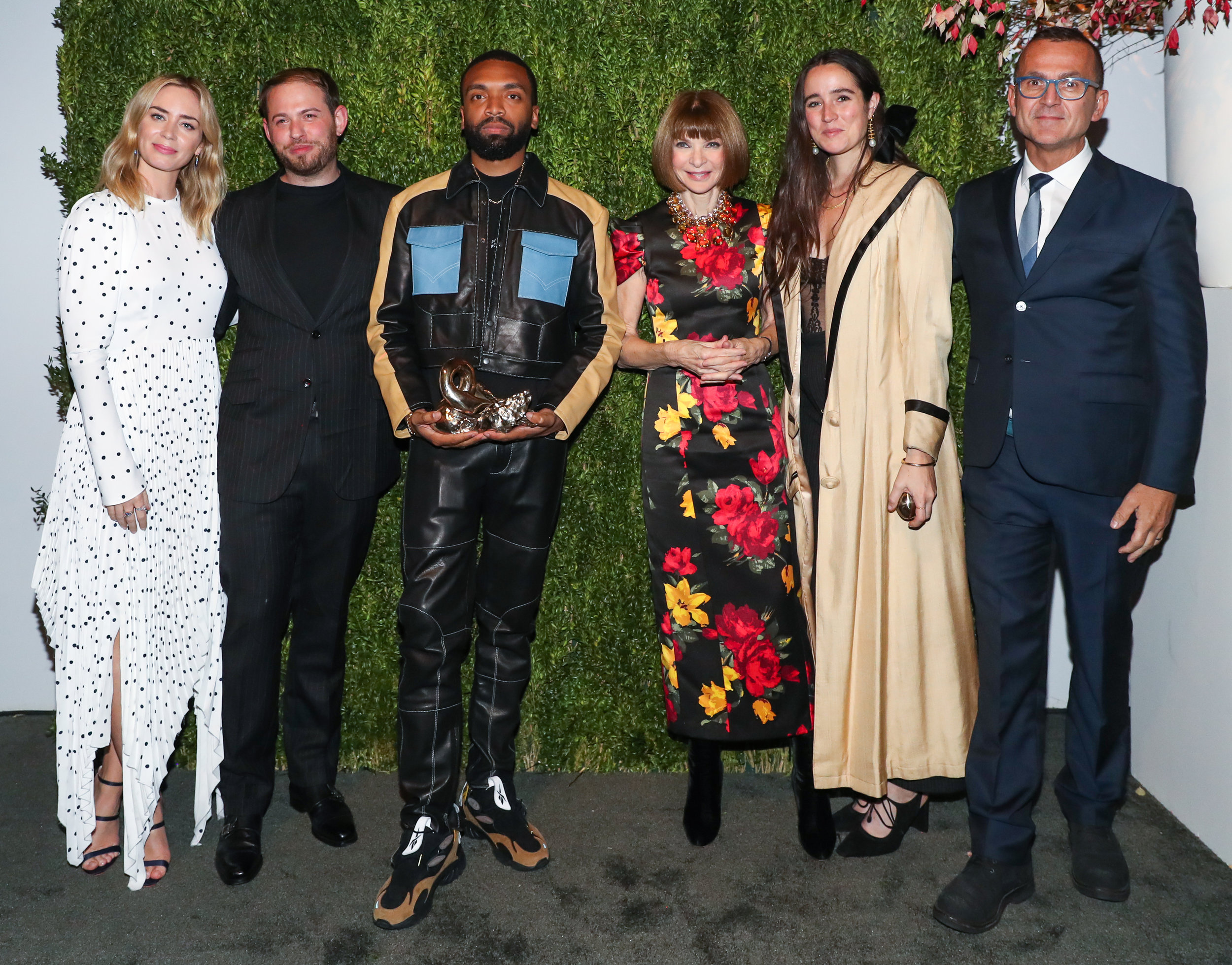 Pictured from left to right: Emily Blunt (presenter of award), runner-up Jonathan Cohen, winner Kerby Jean-Raymond, U.S.  Vogue  EIC Anna Wintour, runner-up Emily Adams Bode, and CFDA chief executive Steven Kolb.  Image    via   .