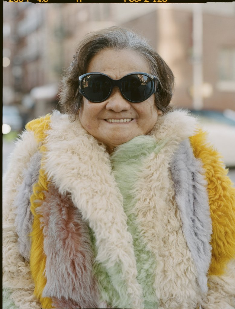Liang's Paw Paw modeling a Sandy Liang multicolored shearling coat.
