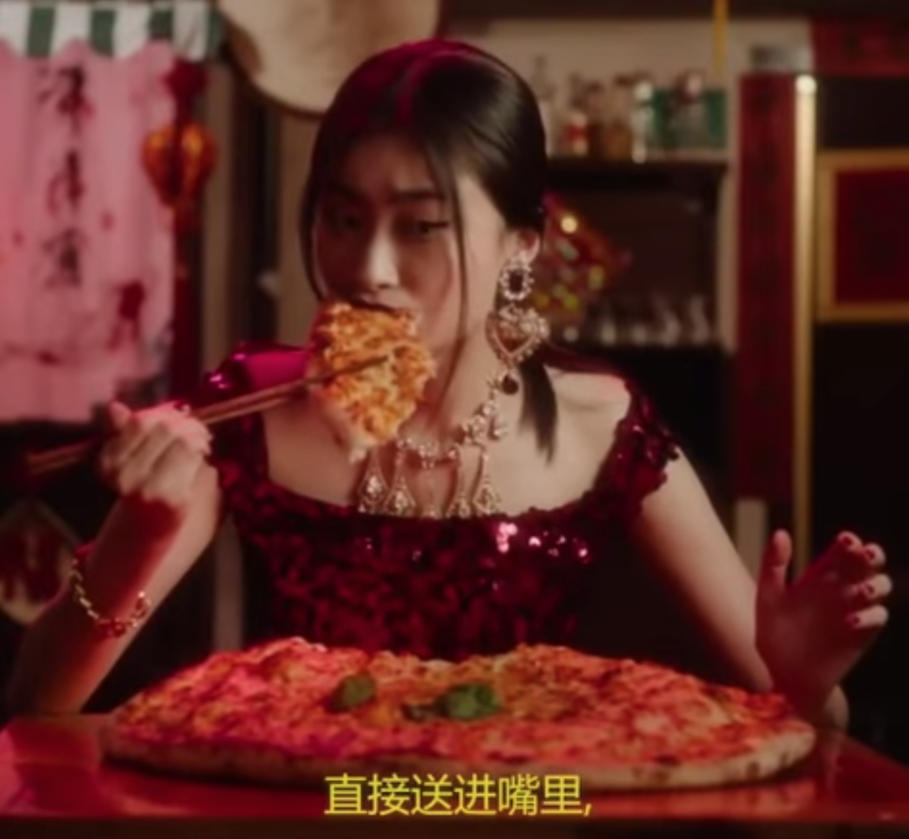 A Chinese model apparently struggles to eat her pizza with chopsticks. Image  via .