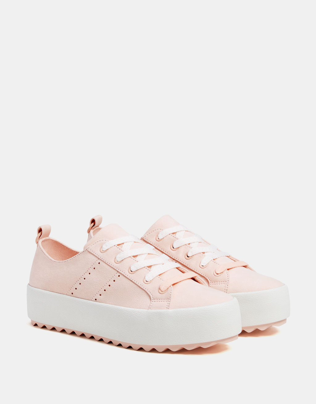 Platform Sneakers - I am a whopping five feet tall (and one inch). I feel like a child sometimes. How I counteract that is by making sure every shoe I own has SOME sort of heel, and now the trendy pale pink sneaker is not safe from me.
