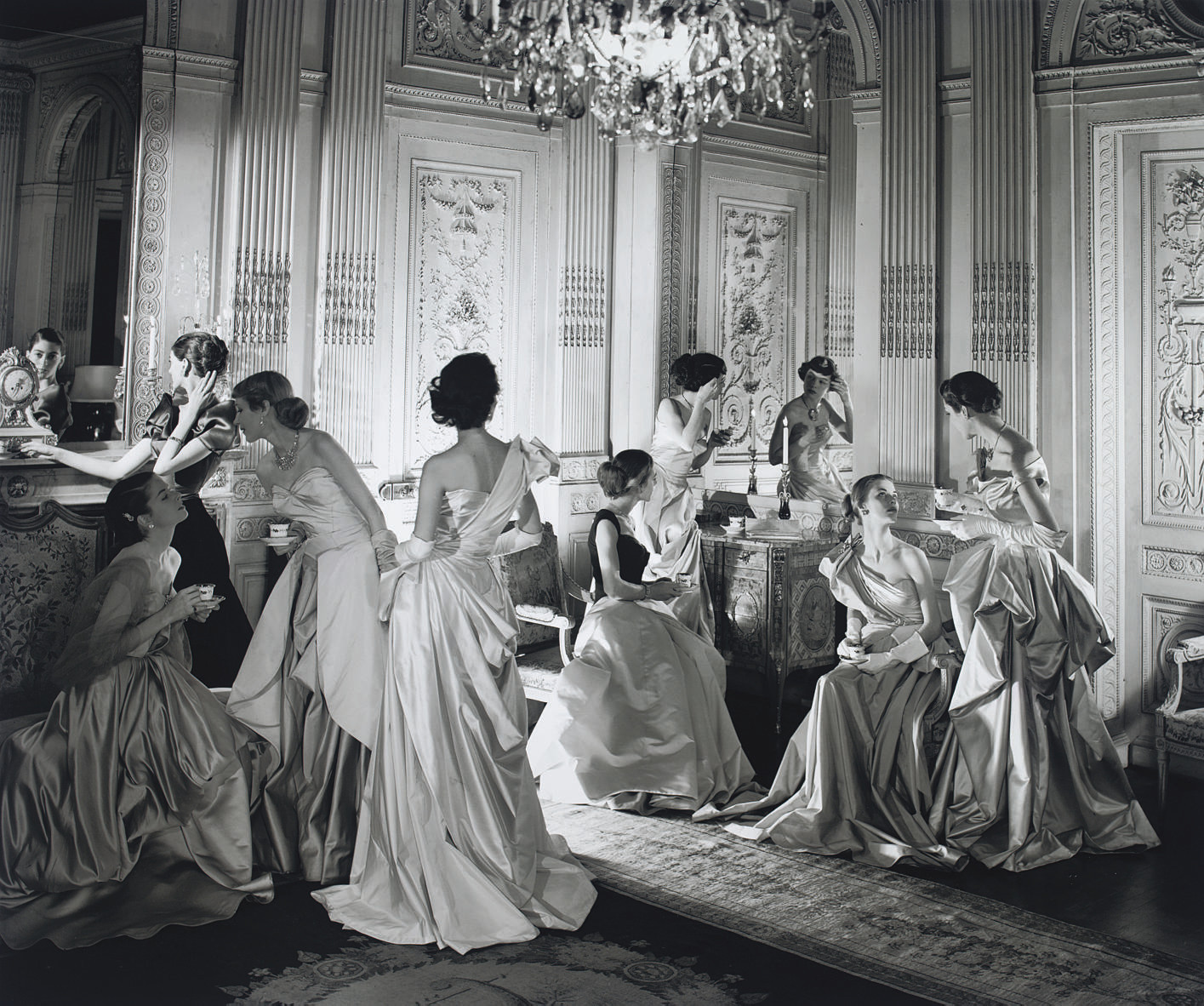 Cecil Beaton's image of ladies wearing James Charles gowns  via .