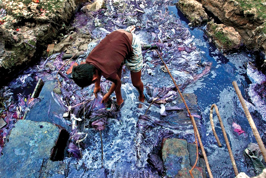 This image reflects the large amounts of water pollution and waste that goes into producing clothing. Source  via .