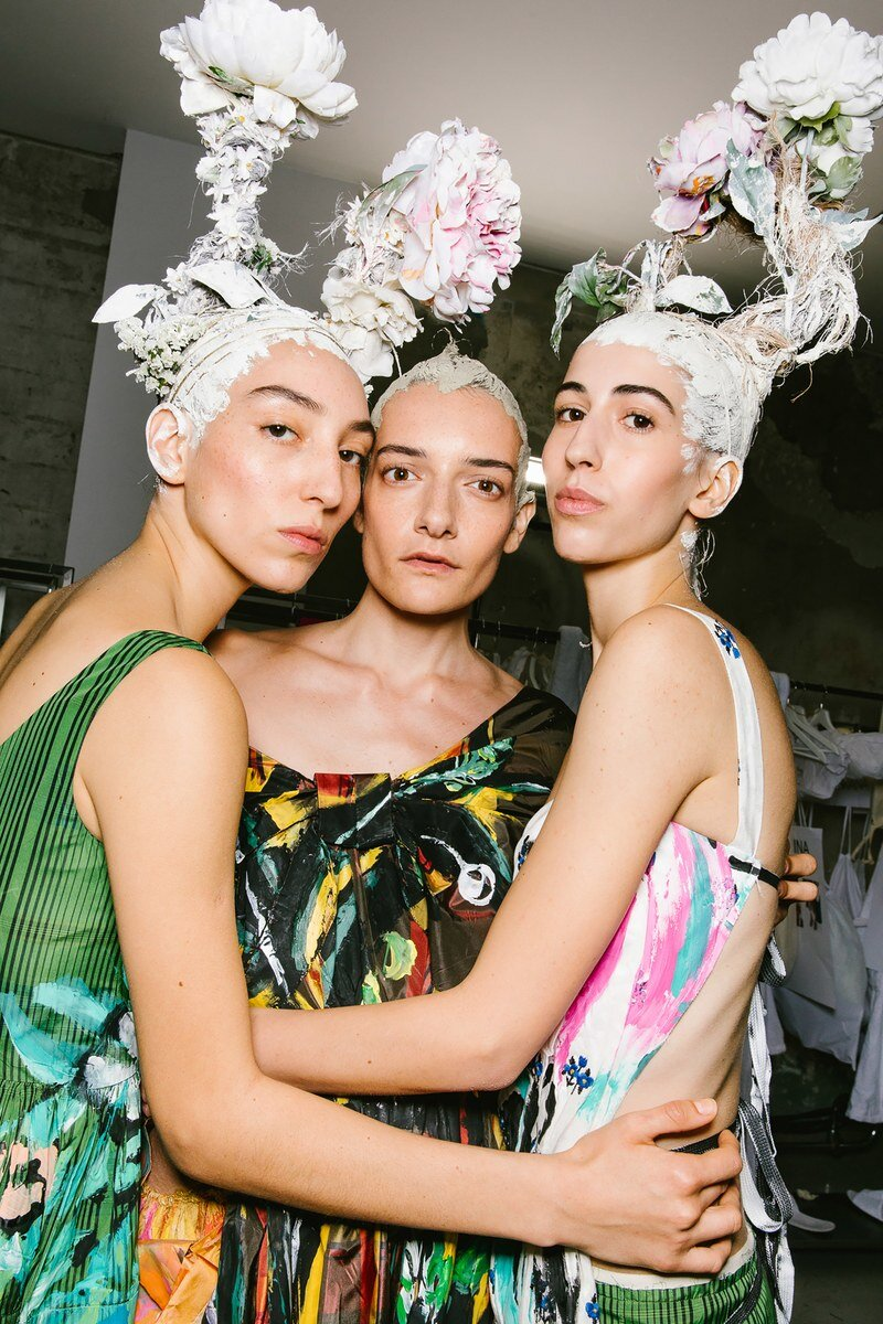 Designers planted many blossoms this season, among other places, Francesco Risso planted them in his models hair at Marni. Image  via