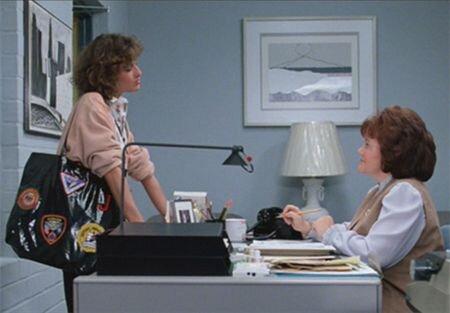 Jeanie Bueller (Jennifer Grey) wearing her iconic black tote bag. Image  Via