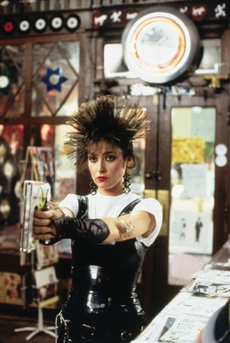 Iona (Annie Potts) shortly after assailing Duckie with staples. Image  Via
