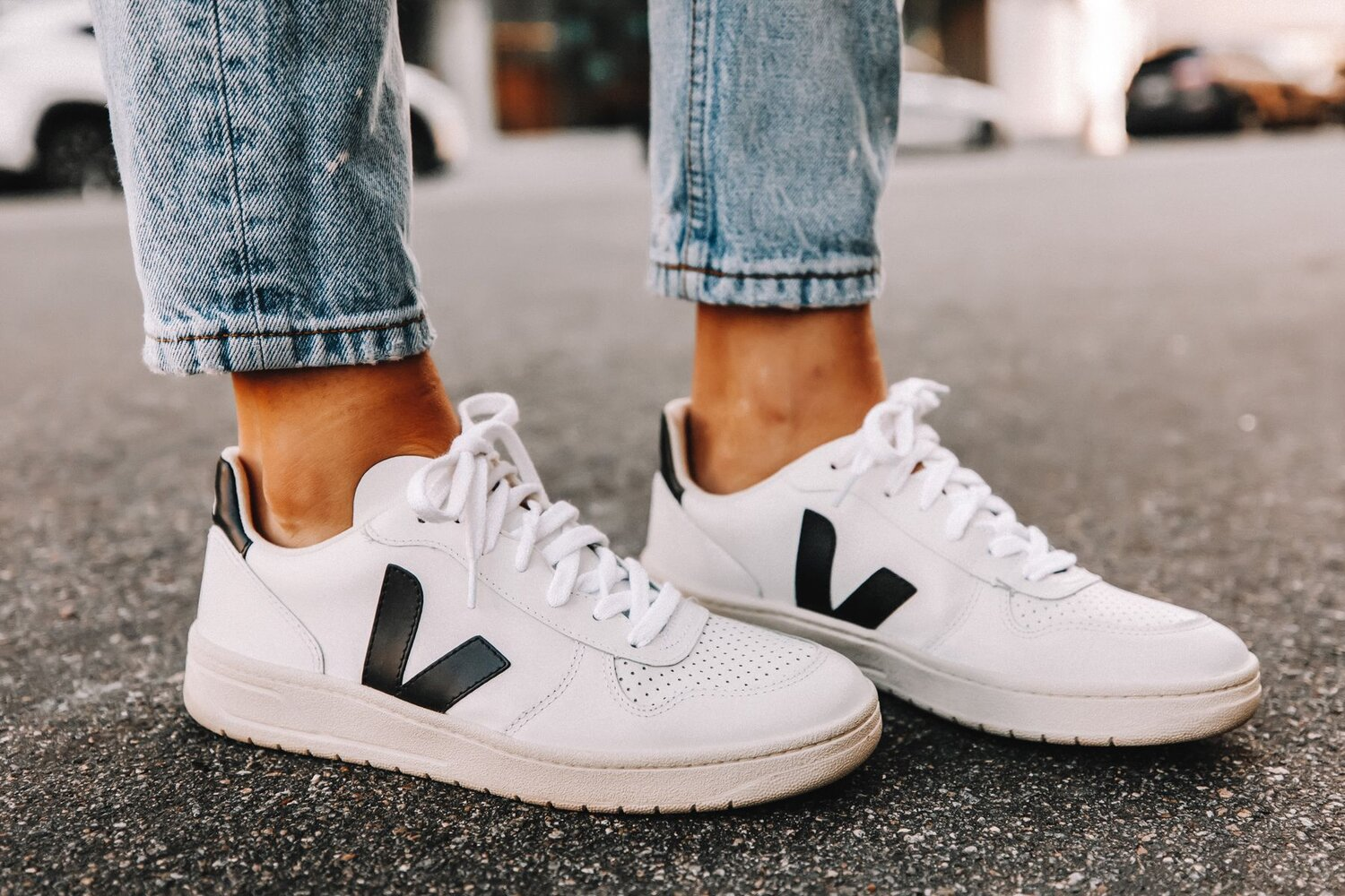 The wildly popular VEJA V-10 is available in a lovely array of materials and color ways, and is perfect for everyday wear. Image  Via