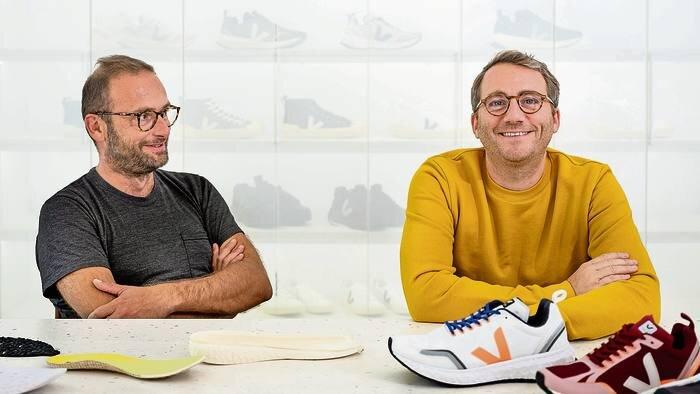 VEJA founders Sebastien Kopp and François-Ghislain Morillion with VEJA running shoes. Image  Via