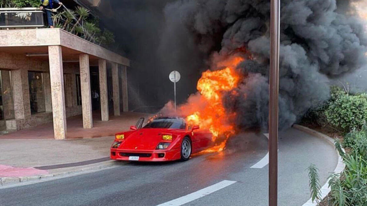 A $1 million Ferrari F40 that burnt to the ground in Monaco earlier this year is immortalized on a L'ART tee shirt and sticker. Image  Via