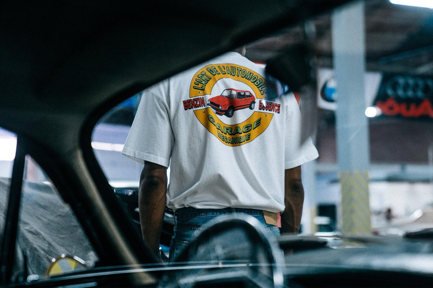A man wears a L'ART logo tee featuring the Volkswagen Golf for Notre. Image  Via
