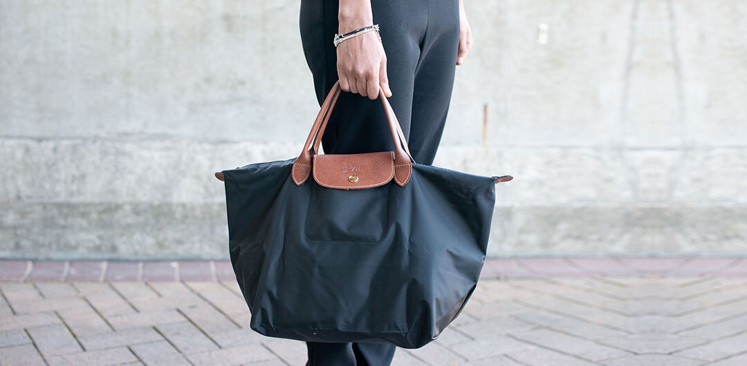 The durable yet stylish Longchamp Le Pliage in black. Image  Via