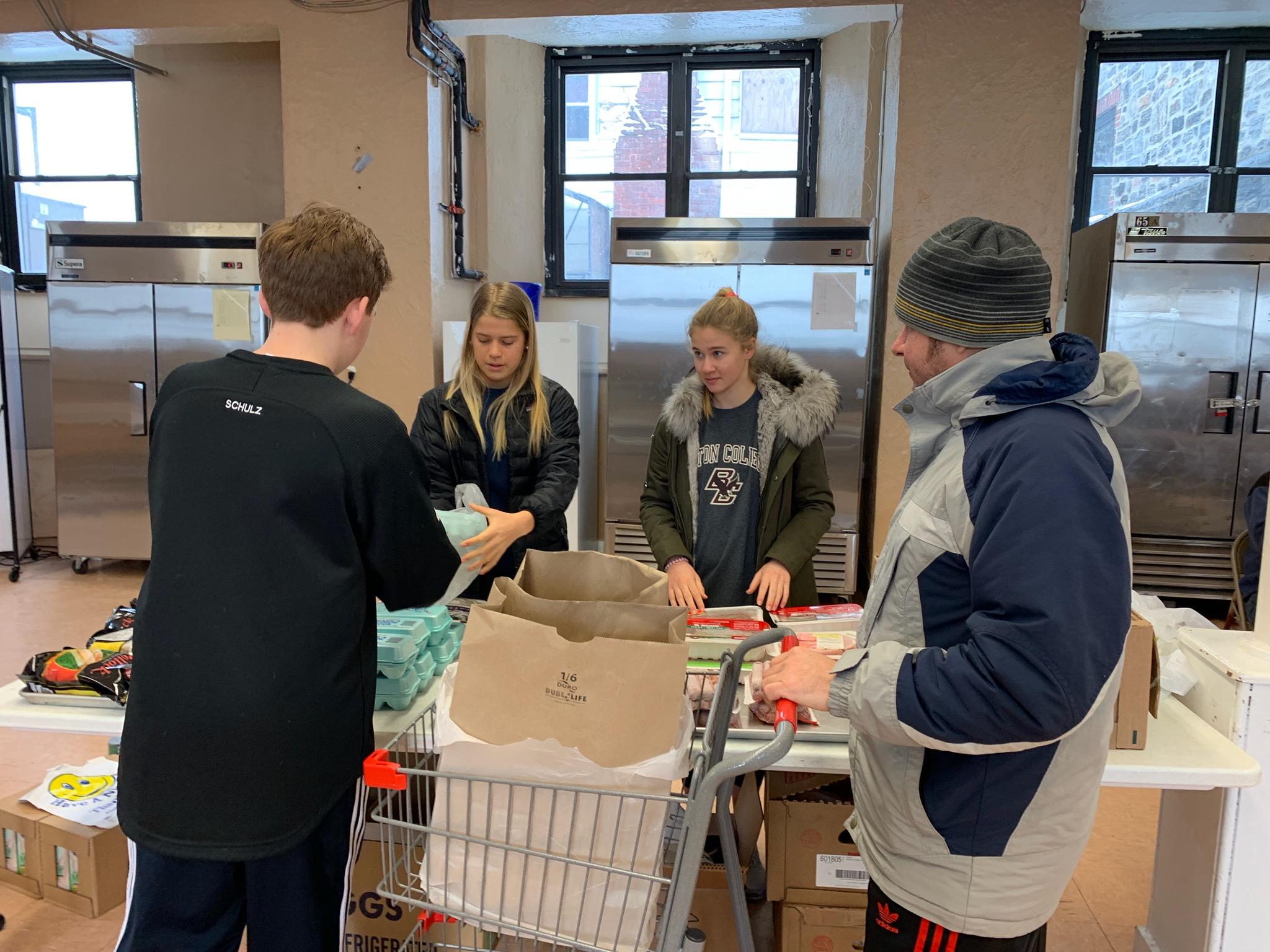 Volunteering to help shop at the CaritasPC choice food pantry.