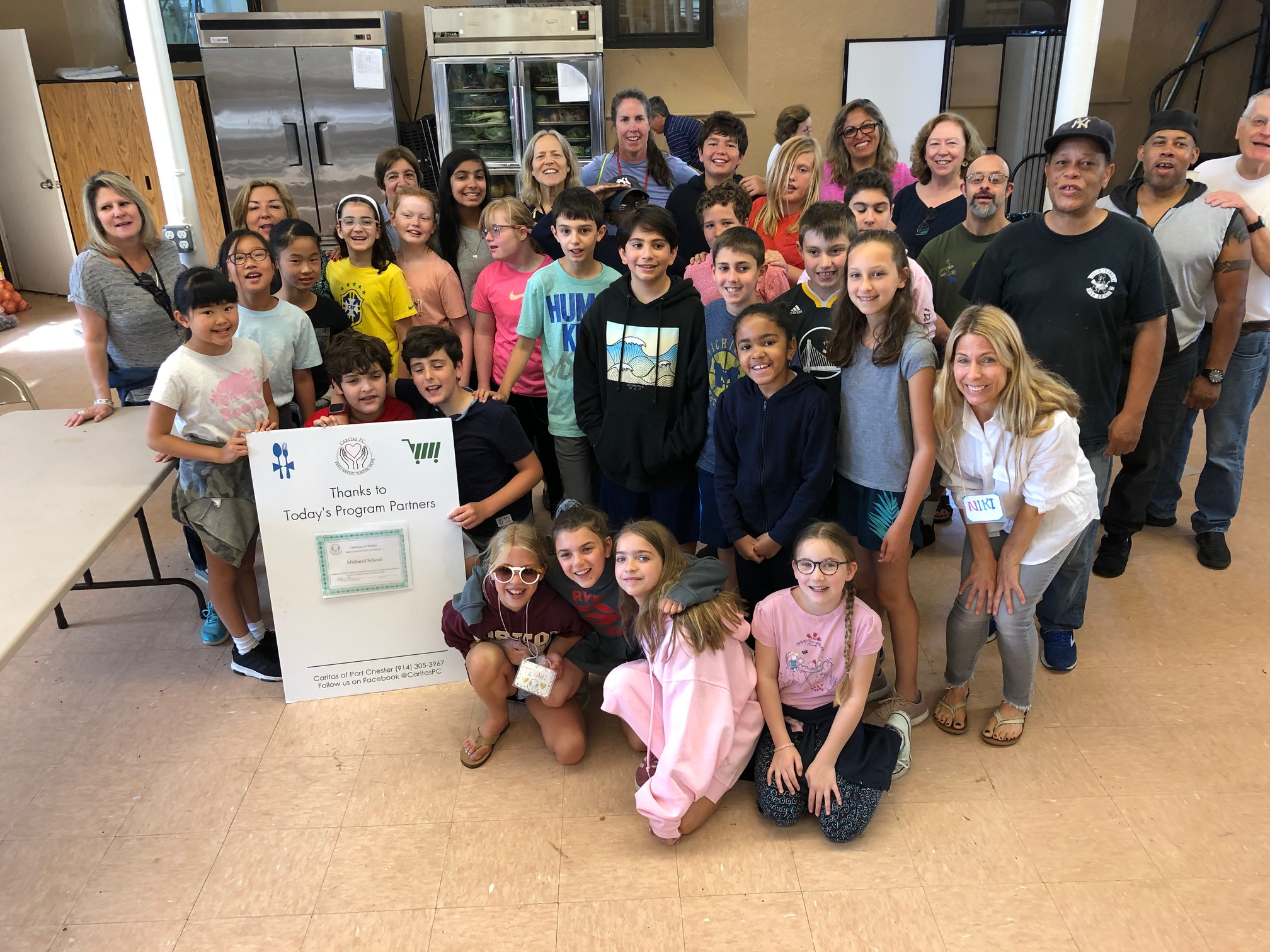 Midland School visits caritasPC to help with Pantry