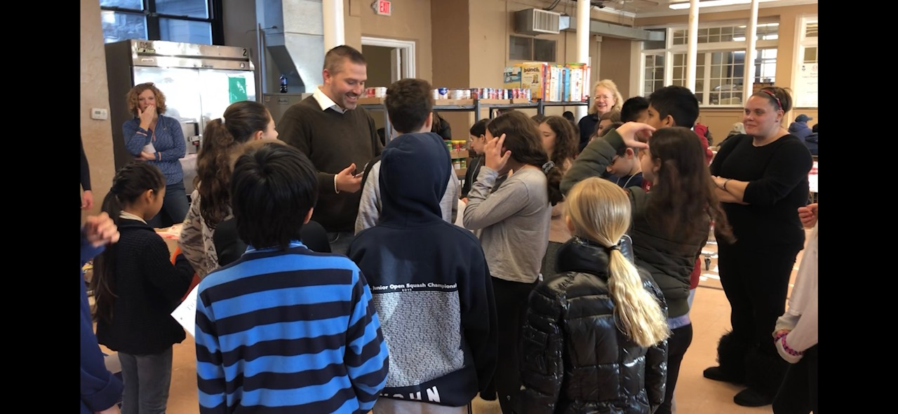 Scarsdale Middle School's Stephen Jackson preps his students before assigning them jobs at our pantry.