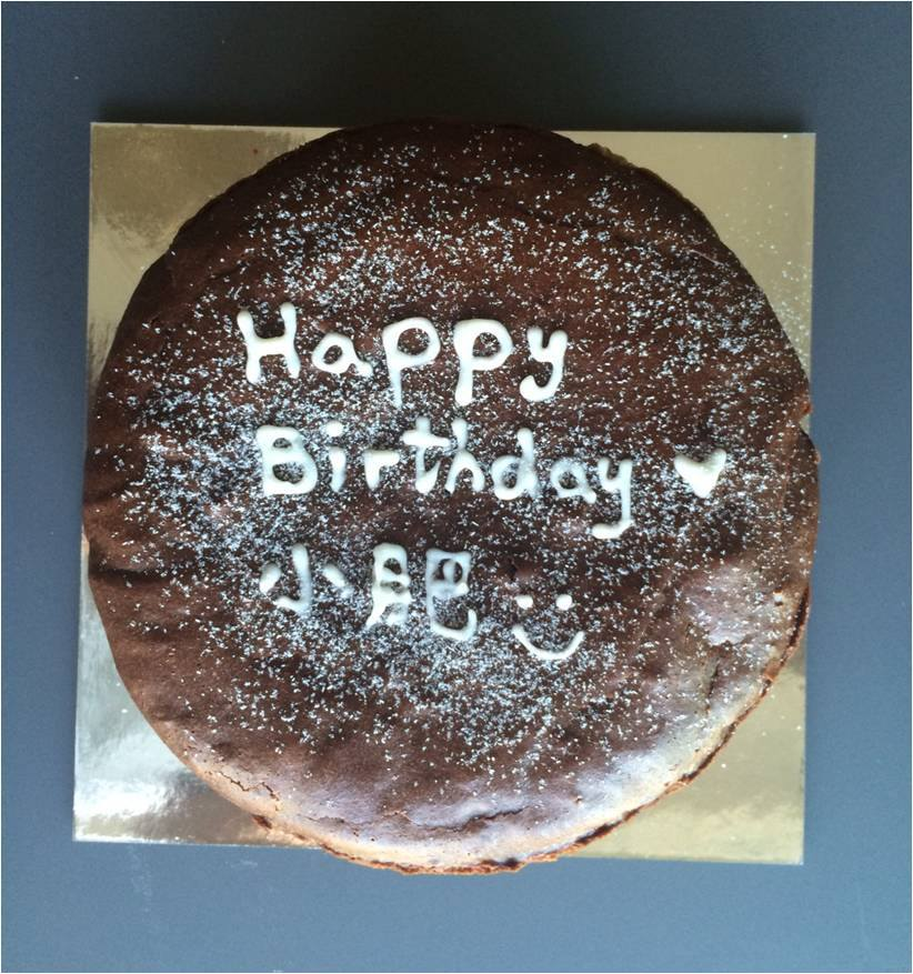 Choc-E-Cheese   New York-style cheesecake infused with dark chocolate and dusted with icing sugar  $350  + 10% delivery  (7 in., white lettering included)