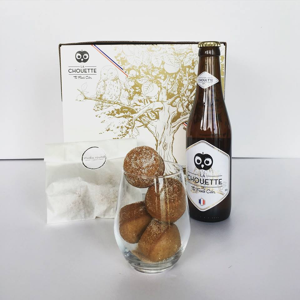La Donette (with  La Chouette )   Baked donut holes infused with cinnamon sugar and La Chouette Apple Cider and dusted with icing sugar  Created for and sold at the Wine & Dine Festival in October 2015