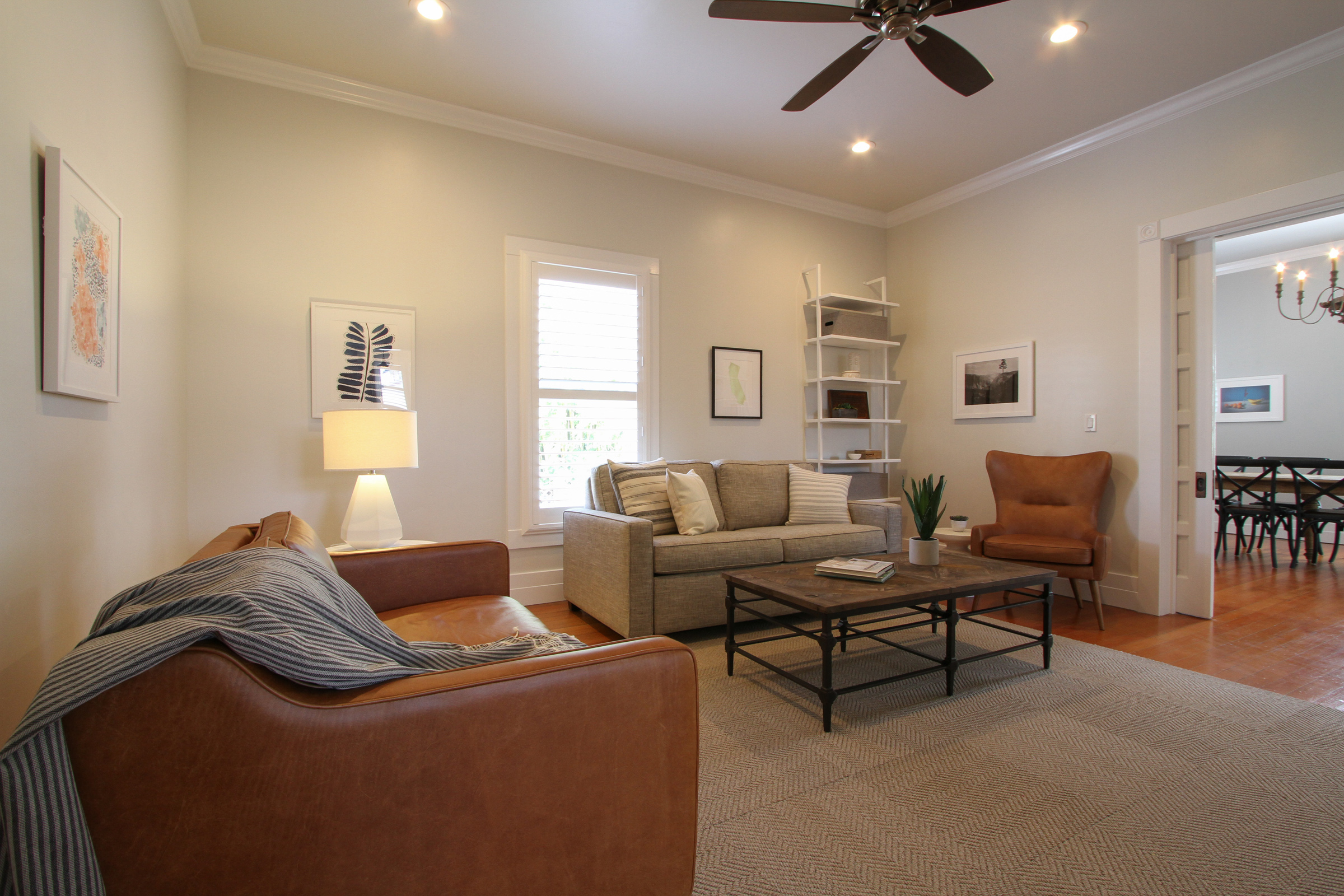 The living room is furnished with a sofa bed.