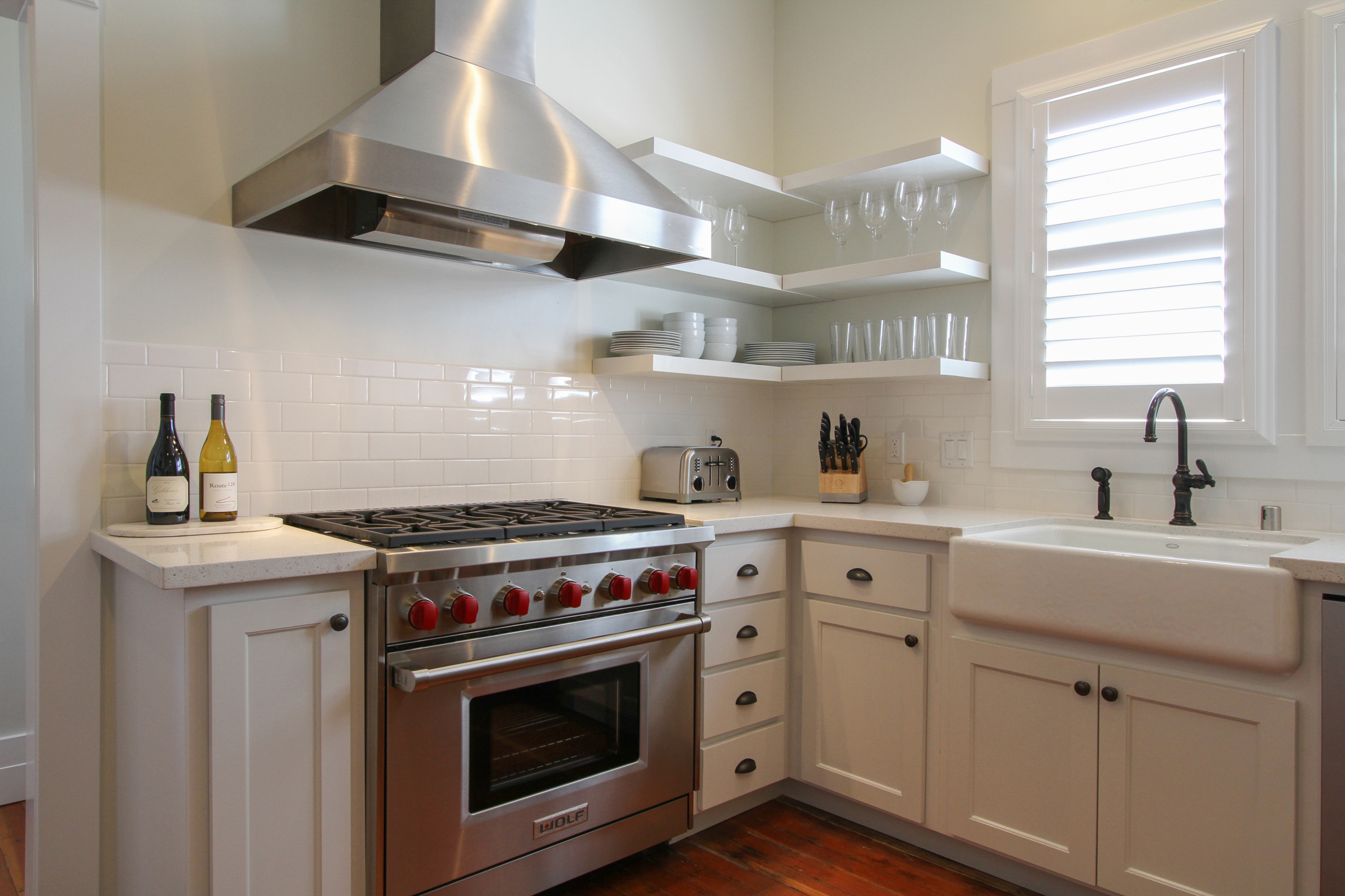 Kitchen with 6 burner Wolf stove.