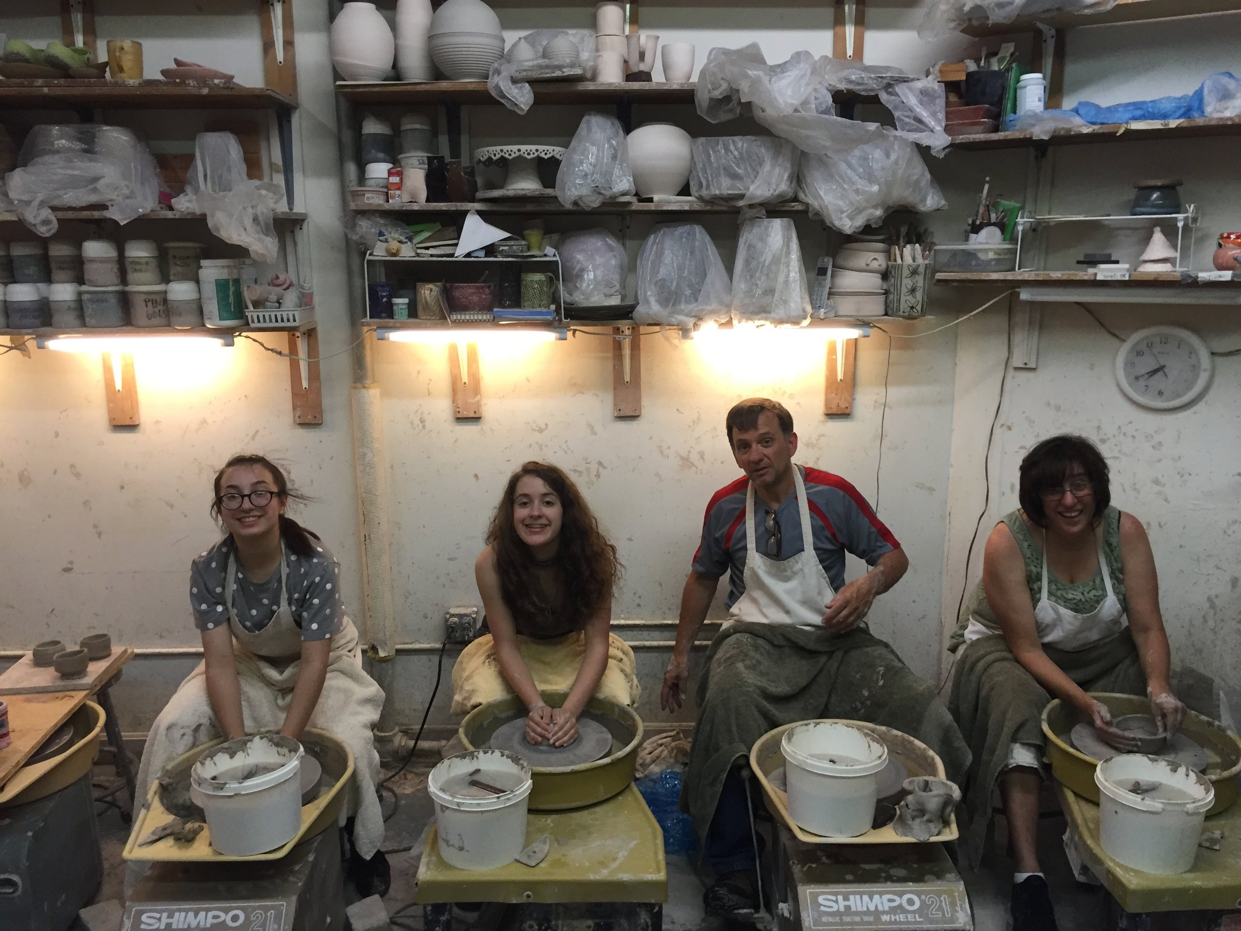 Family doing pottery wheel together!