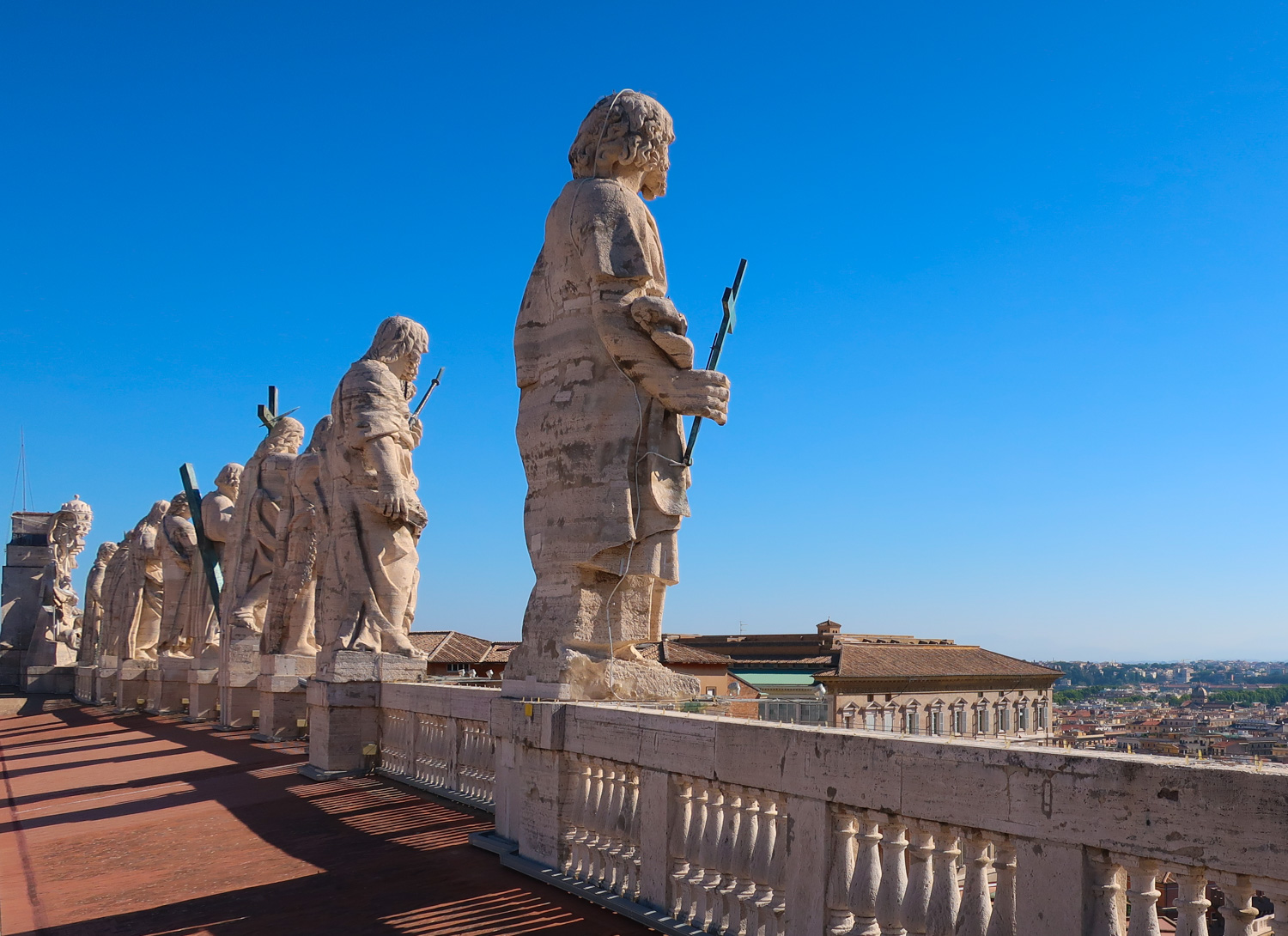 Statues on the Roof of St. Peter's Basilica Rome   Photo: Calvin Wood