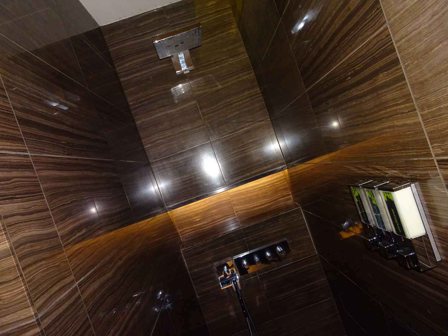 Stone From Floor to Ceiling - Showers - Air Canada Lounge - London Heathrow Photo: Calvin Wood