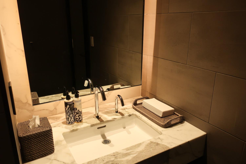 Single Restrooms - United  Polaris Lounge  Houston  Photo: Calvin Wood