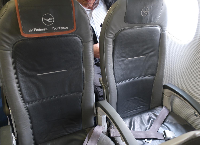 Business Class Seat - Lufthansa Embraer 90  Photo: Calvin Wood