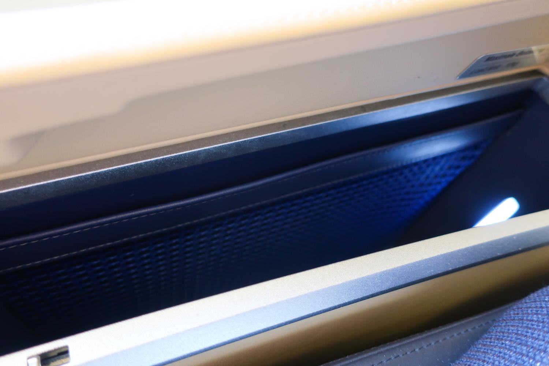 Side Seat Storage Open - Lufthansa First Class A340  Photo: Calvin Wood