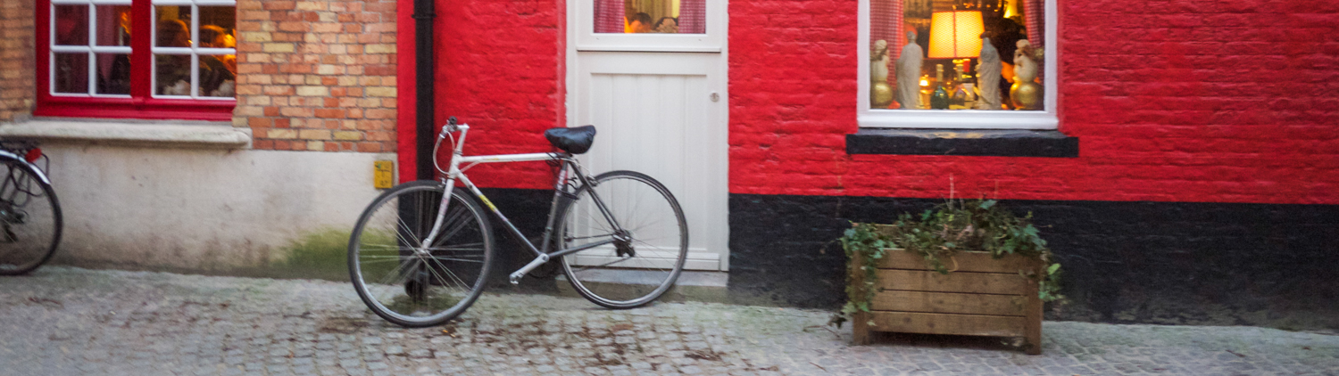 bike against red wall with white door